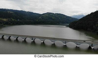 Flying across road bridge. Bicaz mountain river bridge in...