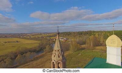 Flying aerial shot near church - Flying aerial shot near...