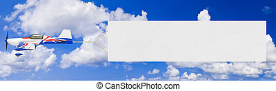Flying airplane and banner