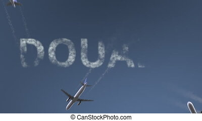 Flying airplanes reveal Douala caption. Traveling to...
