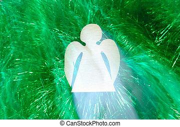 Flying angel against green tinsel