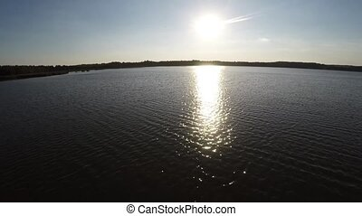 Flying at the time of sunset Lake. - Flying at the time of...