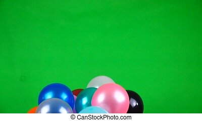 Flying balloons on green screen