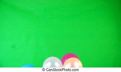 Flying balloons on green screen