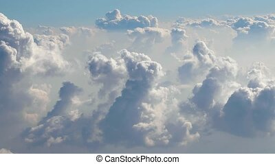Flying betweeen clouds - Flying between clouds, view from...