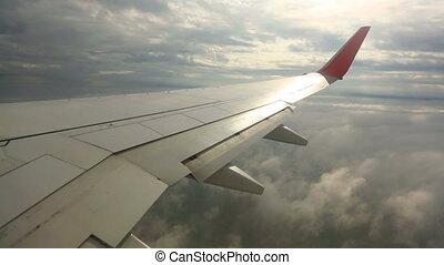Flying between layers of clouds - The plane flies between...