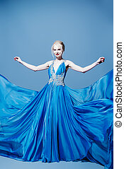 flying blue dress - Full length portrait of a magnificent...