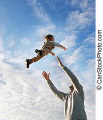 flying boy on sky background