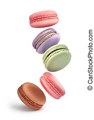 flying colorful macaroons on a white background