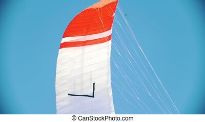 Flying colorful sail for kite boarding in the sky, close up