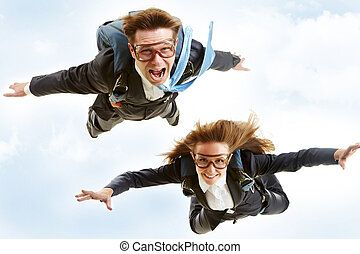 Flying - Conceptual image of young business partners flying...