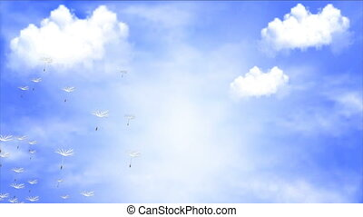 Flying dandelion against the sky with clouds
