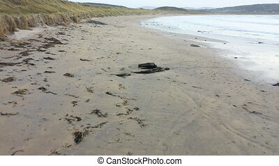 Flying deep above Portnoo Narin beach County Donegal, Ireland