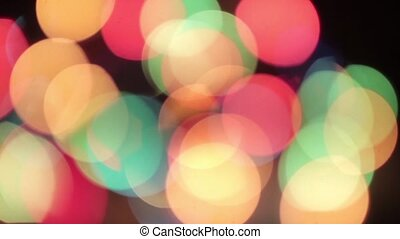 Flying defocused multicolored circles on a black background HD 1920x1080