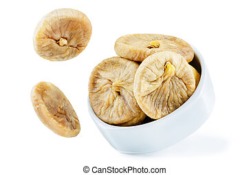 Flying dried Figs fruits in a bowl isolated. toning....