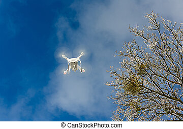 Flying drone in a winter
