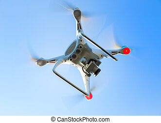 flying drone in blue sky