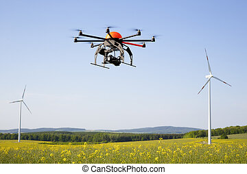Flying drone in field - field in Germany