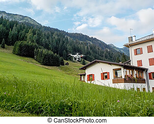 Flying drone in the countryside