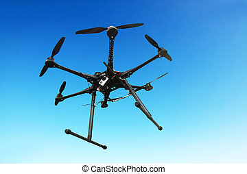Flying drone in the sky