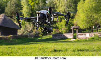 Flying drone is filming in the countryside