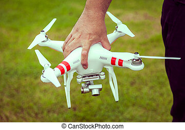 flying drone with camera in hand