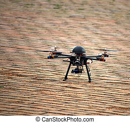 flying drone with camera on ground