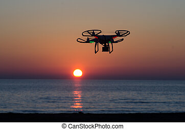 Flying drone with camera on the sky at sunset - Drone flying...