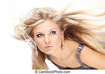 Portrait of beautiful blonde with the flying hair, isolated