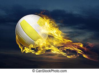flying fiery ball - flying fiery volleyball ball in sky