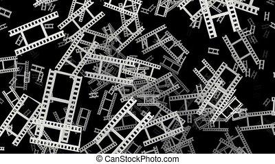 Flying film tape fragments in white on black