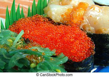 Flying fish roe sushi - Close up of flying fish roe sushi