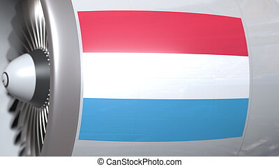 Flying flag of Luxembourg on airliner tourbine engine. Aviation related 3D rendering
