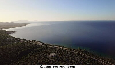 Flying from green coast to blue sea, Greece - Aerial scene...