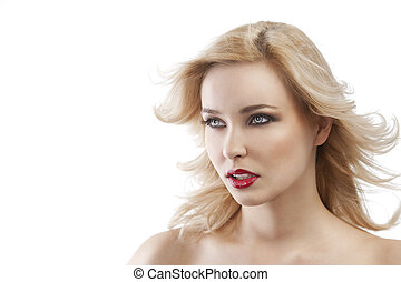 flying hair blond girl, she is turned in three quarters