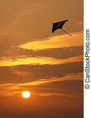 Flying High - A kite flies high in the sky against the ...