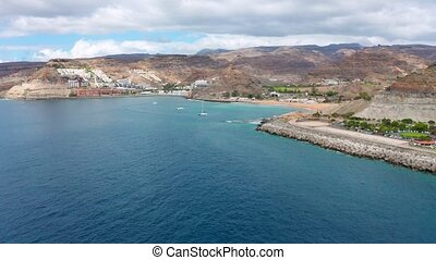 Flying high above beautiful sea and landscape at Gran Canaria