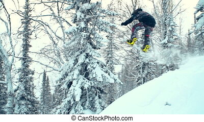 Flying High - Slow motion of snowboard rider jumping from...