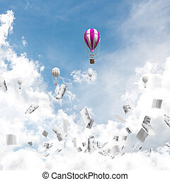 Flying hot air balloons in the air.