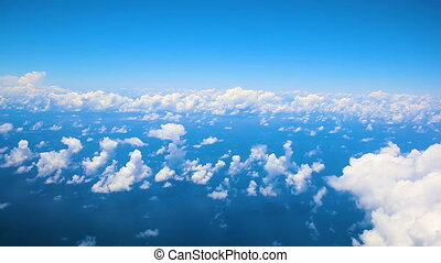 Flying in airplane over Atlantic ocean and clouds showing Earth's atmosphere