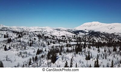 Flying in large mountain winter landscape - Camera flying...
