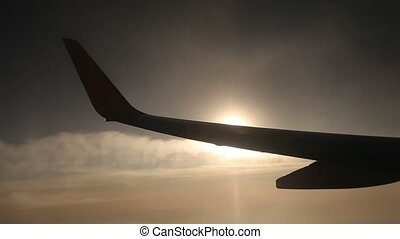 Flying in Sun - video footage of a airplane with sun