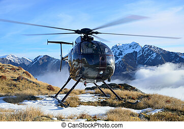 flying in the alps - Helicopter waiting for hunters in South...