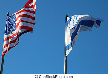 Flying in the blue sky American flag and the Israeli flag -...