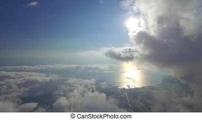 flying in the clouds - flying above the clouds in the...