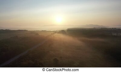 Flying into the foggy sunrise in County Donegal with fog - Ireland.