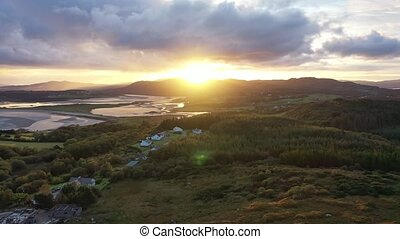 Flying into the sunrise over Ballyiriston in County Donegal - Ireland