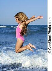 flying jump beach girl in blue sea shore