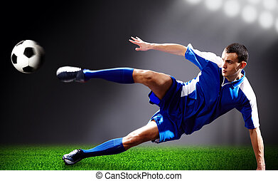 Flying kick - Image of soccer player doing flying kick with...