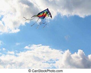 Flying kite - Kite is flying in a blue sky